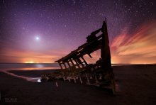 """Ghost Ship 1"" - The sunken remains of the Peter Iredale, with Venus shining brightly overhead. Near Fort Stevens, Oregon."